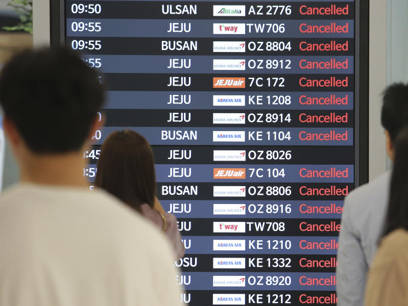 An electronic signboard shows canceled domestic flights at the Gimpo International Airport in Seoul, South Korea, Saturday, Sept. 7, 2019. Typhoon winds toppled trees, grounded planes and left thousands of South Korean homes without electricity on Saturday as a powerful storm system brushed up against the Korean Peninsula. (AP Photo/Ahn Young-joon)