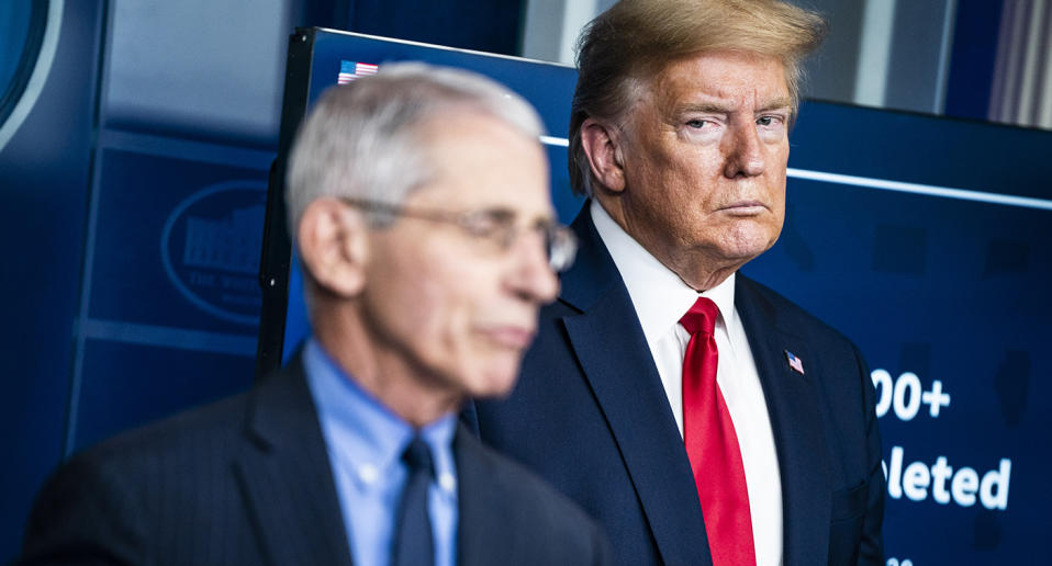President Donald J. Trump listens to Dr. Anthony Fauci, director of the National Institute of Allergy and Infectious Diseases, speak with members of the coronavirus task force during a briefing in response to the COVID-19 coronavirus pandemic.