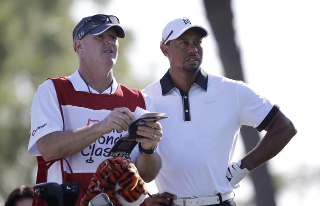 Golfer Tiger Woods, right, and his caddie Joe LaCava look over the course on the fourth tee during the Pro-Am round of the Honda Classic golf tournament, Wednesday, Feb. 26, 2014 in Palm Beach Gardens, Fla. (AP Photo/Wilfredo Lee)