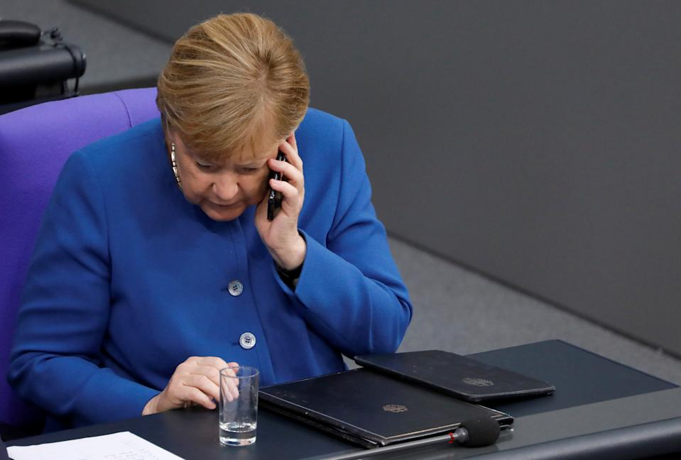 German Chancellor Angela Merkel speaks on the phone as she attends a session of Germany's lower house of parliament Bundestag in Berlin, Germany October 17, 2019 REUTERS/Michele Tantussi