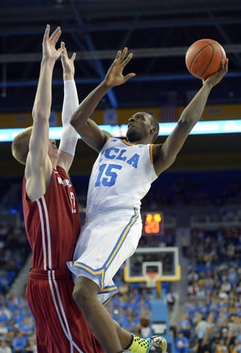 CORRECTS TO SECOND HALF, NOT FIRST- UCLA guard/forward Shabazz Muhammad, right, puts up a shot as Washington State forward Brock Motum defends during the second half of their NCAA college basketball game, Saturday, Feb. 9, 2013, in Los Angeles. (AP Photo/Mark J. Terrill)