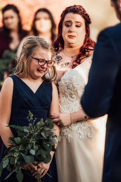 PHOTO: Olivia Jewart is seen crying as her stepfather, Jimmy Gisondi, read vows to her. (Abigail Gingerale Photography)