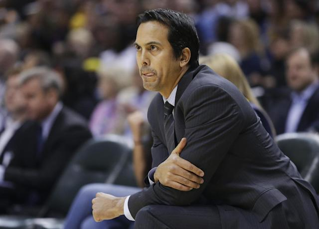 Miami Heat head coach Erik Spoelstra watches from the bench in the first half of an NBA basketball game against the Indiana Pacers in Indianapolis, Tuesday, Dec. 10, 2013 (AP Photo/Michael Conroy)