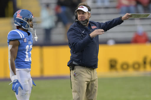 Mississippi head coach Lane Kiffin, right, talks to wide receiver Braylon Sanders (13) during the first half of an NCAA college football game against LSU in Baton Rouge, La., Saturday, Dec. 19, 2020. (AP Photo/Matthew Hinton)