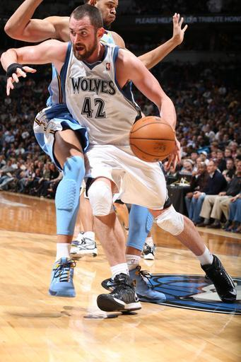 MINNEAPOLIS, MN - NOVEMBER 21: Kevin Love #42 of the Minnesota Timberwolves drives under pressure during the game between the Minnesota Timberwolves and the Denver Nuggets on November 21, 2012 at Target Center in Minneapolis, Minnesota. (Photo by David Sherman/NBAE via Getty Images)