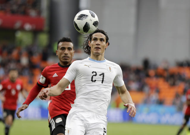 Uruguay's Edinson Cavani controls the ball during the group A match between Egypt and Uruguay at the 2018 soccer World Cup in the Yekaterinburg Arena in Yekaterinburg, Russia, Friday, June 15, 2018. (AP Photo/Natacha Pisarenko)