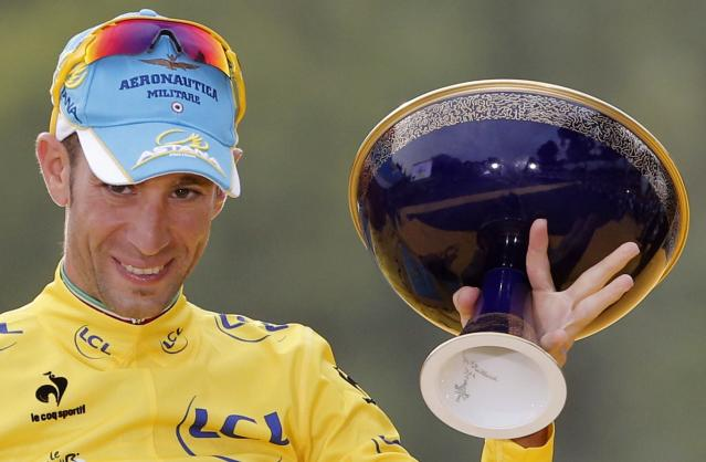 Race winner Vincenzo Nibali of Italy, wearing the overall leader's yellow jersey, gestures as he celebrates on the podium of the Tour de France in Paris, France, Sunday, July 27, 2014. (AP Photo/Christophe Ena)