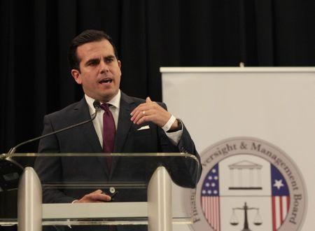Puerto Rico's Governor Ricardo Rossello addresses the audience during a meeting of the Financial Oversight and Management Board for Puerto Rico at the Convention Center in San Juan