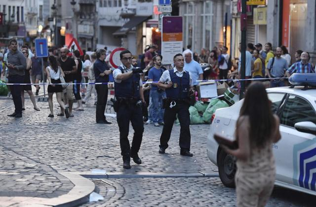 <p>Belgian police evacuate people near the Grand Place near Central Station in Brussels after a reported explosion on Tuesday, June 20, 2017. Belgian media are reporting that explosion-like noises have been heard at a Brussels train station, prompting the evacuation of a main square. (AP Photo/Geert Vanden Wijngaert) </p>