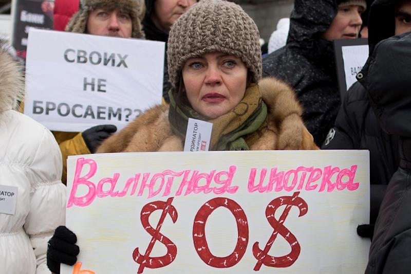 A woman at a protest by Russian holders of dollar denominated mortgages (AFP Photo/Dmitry Serebryakov)