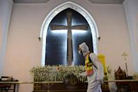Millions of Christians are marking Easter under coronavirus restrictions as many nations battle Covid-19 surges