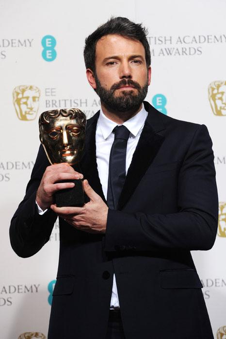 Ben Affleck poses with his Best Director Award in the press room at The EE British Academy Film Awards 2013 at The Royal Opera House on February 10, 2013 in London, England. (Photo by Dave J Hogan/Getty Images)