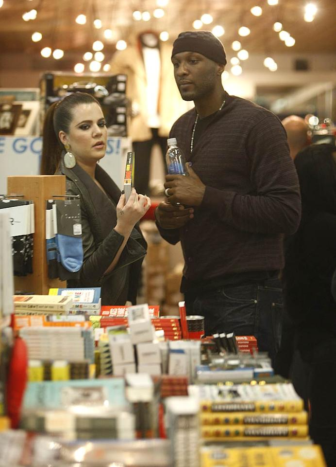 With all of the big events going on in her sisters' lives (i.e. Kim's divorce, Kourtney's pregnancy), Khloe Kardashian tried to keep things low-key by doing a little holiday shopping with hubby Lamar Odom at Kitson in Beverly Hills on Thursday. (12/1/2011)