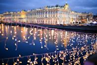 <p>Christmas lights on Palace Bridge with the State Hermitage Museum in the background. (Peter Kovalev\TASS via Getty Images) </p>