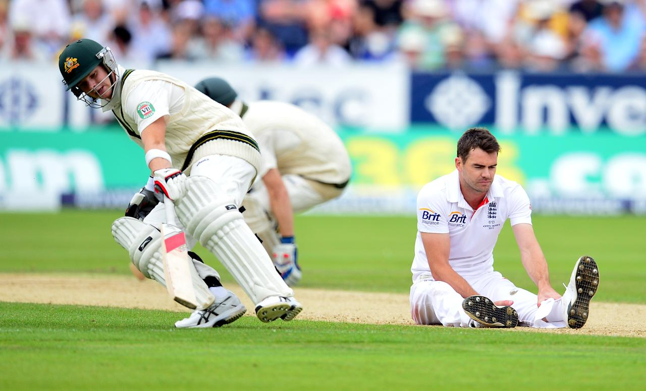 Australia's Steve Smith runs past a dejected James Anderson during day two of the Fourth Investec Ashes test match at the Emirates Durham ICG, Durham.