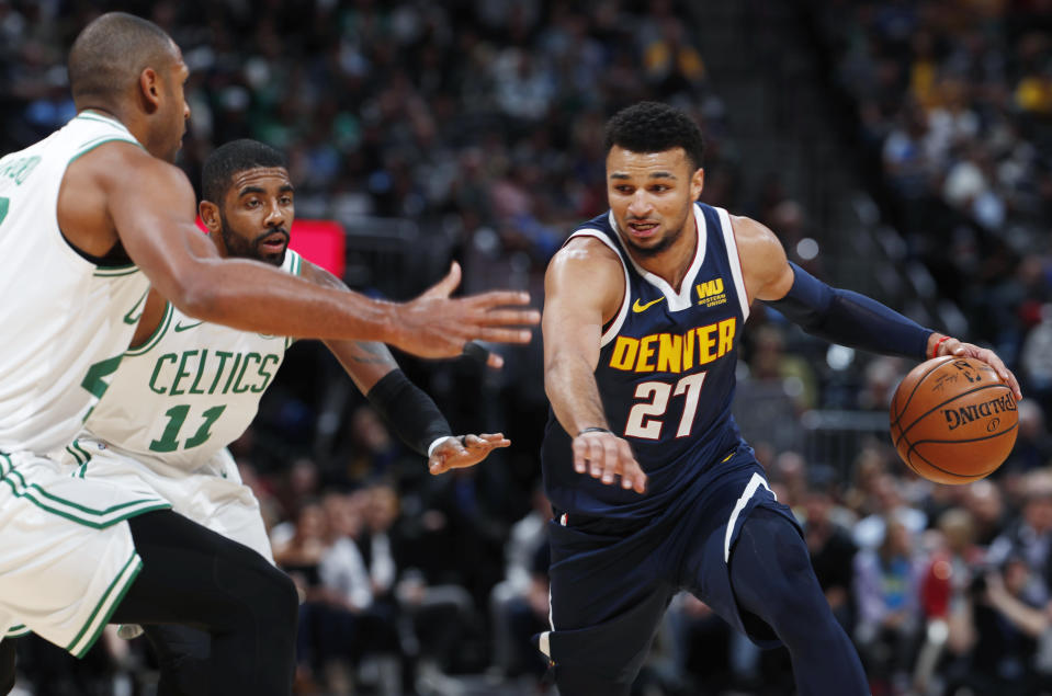 Kyrie Irving's heaving of the game ball might have been the only time he bothered Jamal Murray all night as the Nuggets guard dropped 48 on the Celtics. (AP Photo)