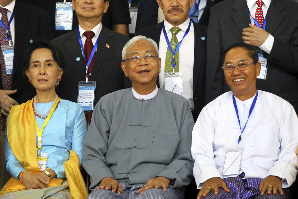 FILE - In this May 24, 2017, file photo, Myanmar's Vice President Myint Swe, right, smiles while sitting with State Counsellor Aung San Suu Kyi, left, and then President Htin Kyaw during a photo session after the second session of the 21st Century Panglong Union Peace Conference at the Myanmar International Convention Center in Naypyitaw, Myanmar. The future of the Myanmar's already-fragile peace process between the military, ethnic armed groups and militias is in question as the military regains control of the country after the Feb. 1, 2021 coup. (AP Photo/Aung Shine Oo, File)
