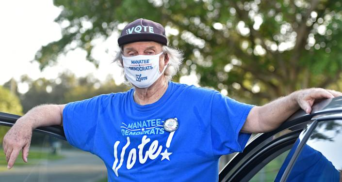 """Democratic Party volunteers along with Bob McCaa have been coordinating """"no knock"""" no contact door-to-door canvassing efforts where he and local volunteers drop off information on voting and the candidates. Here McCaa, canvassing the Ayres Point neighborhood in north east Bradenton on Wednesday afternoon, Oct. 28, 2020."""