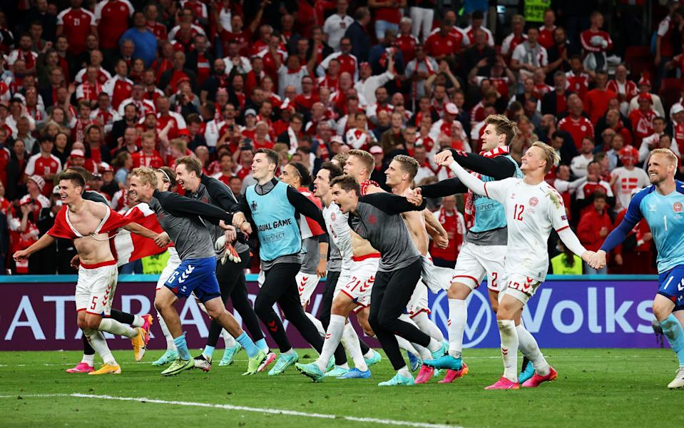 Denmark players celebrate in front of their fans following their 2-1 win over Russia in Copenhagen on Monday. The victory sets up a round of 16 meeting with Wales (Getty)