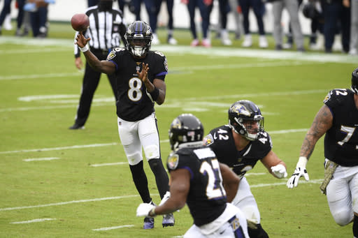 Baltimore Ravens quarterback Lamar Jackson (8) throws a pass to running back J.K. Dobbins (27) on a 2-point conversion play against the Tennessee Titans during the first half of an NFL football game, Sunday, Nov. 22, 2020, in Baltimore. (AP Photo/Nick Wass)