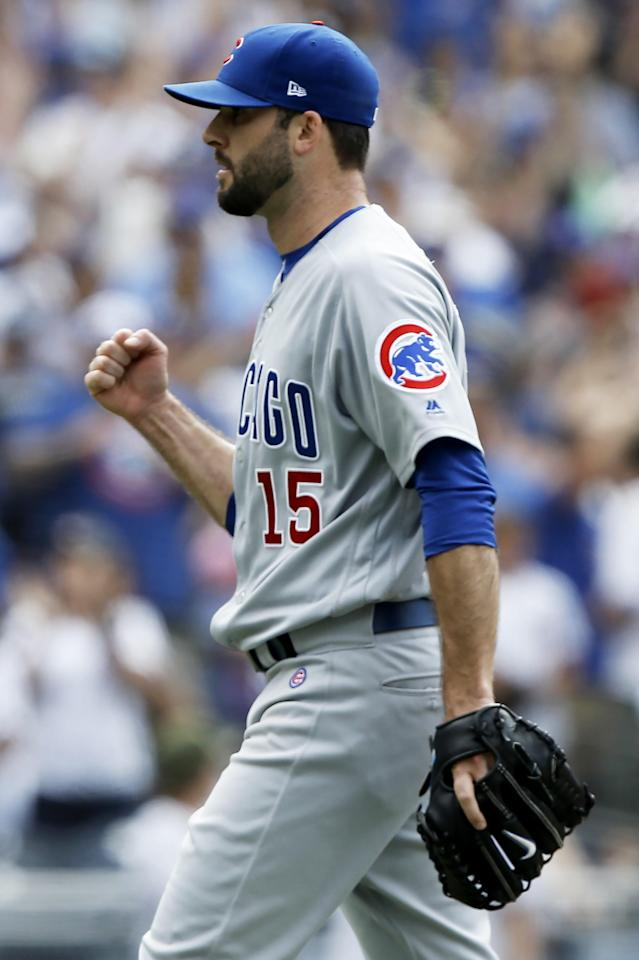 Chicago Cubs relief pitcher Brandon Morrow pumps his fist after striking out San Diego Padres' Eric Hosmer during the ninth inning of a baseball game in San Diego, Sunday, July 15, 2018. (AP Photo/Alex Gallardo)