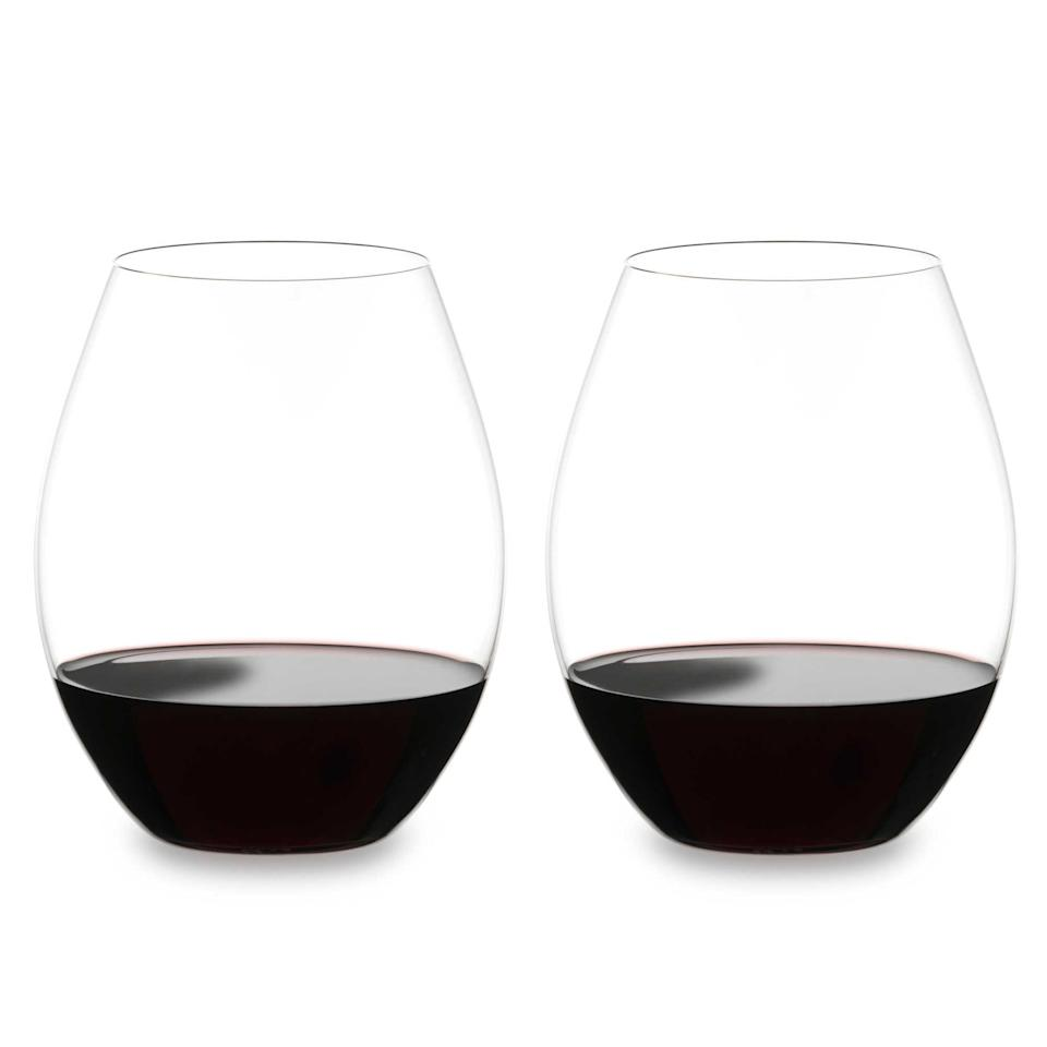 """<p>Nothing makes you feel more grown than having a legit set of matching wine glasses. For the wine-lover who also loves to entertain, this set of <span>Riedel O Merlot Stemless Wine Glasses</span> ($90) is the perfect gift. Made from high-quality crystal, the modern shape is designed to enhance flavor, and best of all, survive the dishwasher. </p> <p><strong>Tip: </strong><a href=""""http://www.costco.com/Riedel-%22O%22-Series-Wine-Tumblers-CabernetMerlot.product.100118973.html"""" class=""""link rapid-noclick-resp"""" rel=""""nofollow noopener"""" target=""""_blank"""" data-ylk=""""slk:Costco members can get this wine glass set for $65"""">Costco members can get this wine glass set for $65</a>! Both retailers include free shipping.</p>"""