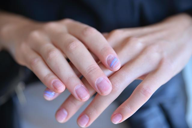 <p>Jin Soon Choi went for the unexpected with a single bold stripe accent on one nail in a shade of purple or black. To get this look: yse a striping tool to make one stripe bolder than the other. Depending on your mood, you can draw it on horizontally or vertically. (Photo: Essie) </p>