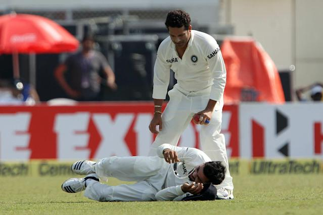 Sachin Tendulkar of India tends to Virat Kholi of India after he was injured during day three of the first Star Sports test match between India and The West Indies held at The Eden Gardens Stadium in Kolkata, India on the 8th November 2013 Photo by: Ron Gaunt - BCCI - SPORTZPICS