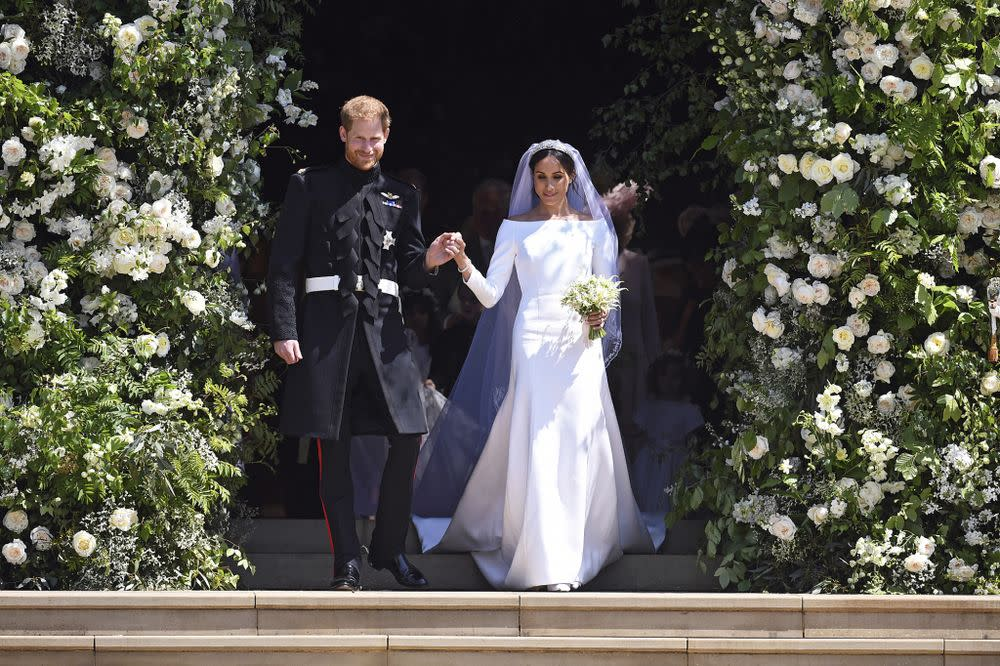 Prince Harry and Meghan Markle leave St. George's Chapel at Windsor Castle after their Saturday wedding