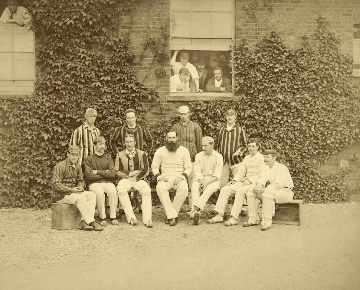 circa 1882: England (1880 - 1899) and Gloucestershire cricketer Dr W G (William Gilbert) Grace (1848 - 1915). On the far right is Allan Steel (1858 - 1914) and on the left of Grace, in blazer and pads, is Albert Neilson Hornby, aka Monkey Hornby (1847 - 1925). In the window is Australian captain W. L. Murdoch. Possibly the Gentlemen of England (amateurs) who are playing the Australians at the Oval on June 22nd, 23rd and 24th, 1882.  (Photo by London Stereoscopic Company/Getty Images)