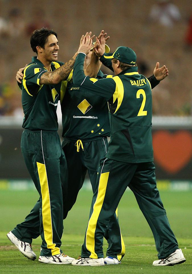MELBOURNE, AUSTRALIA - JANUARY 11:  Mitchell Johnson of Australia celebrates the wicket of Thisara Perera of Sri Lanka during game one of the Commonwealth Bank One Day International series between Australia and Sri Lanka at Melbourne Cricket Ground on January 11, 2013 in Melbourne, Australia.  (Photo by Robert Prezioso/Getty Images)