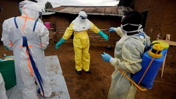 PHOTO: Kavota Mugisha Robert, a healthcare worker, vdecontaminates his colleague after he entered the house of 85-year-old woman, suspected of dying of Ebola, in the eastern Congolese town of Beni in the Democratic Republic of Congo, Oct. 8, 2019. (Zohra Bensemra/Reuters, FILE)