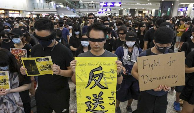 Protesters on Saturday staged a sit-in protest at the Hong Kong International Airport, with similar scenes expected later on Sunday. Photo: Felix Wong
