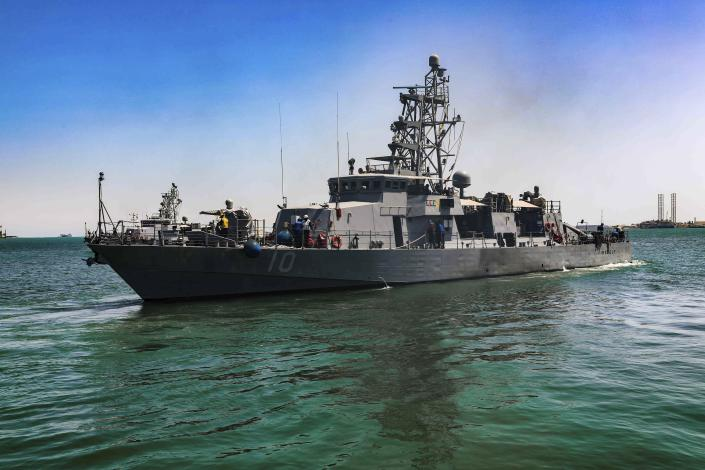 FILE - This April 14, 2020, file photo provided by the U.S. Army shows the USS Firebolt in Manama, Bahrain. The Firebolt fired warning shots when vessels of Iran's paramilitary Revolutionary Guard came too close to a recent patrol in the Persian Gulf, the U.S. Navy said Wednesday, April 28, 2021. (Spc. Cody Rich/U.S. Army via AP)