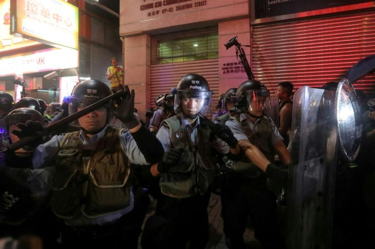 Riot police charged protesters in the district of Mongkok (AFP Photo/VIVEK PRAKASH)