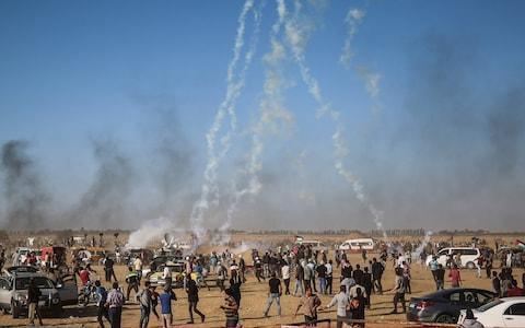 <span>Israeli security forces fire tear gas canisters over Palestinians near Khan Yunis, Gaza </span> <span>Credit: Anadolu </span>