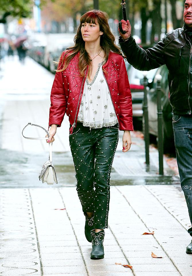 Jessica Biel looked like a Christmas nightmare while strolling the rainy streets of Paris in this garish red-and-green studded leather getup, featuring a matching pair of cowboy ankle boots. What <em>was</em> she thinking?! (10/8/2012)
