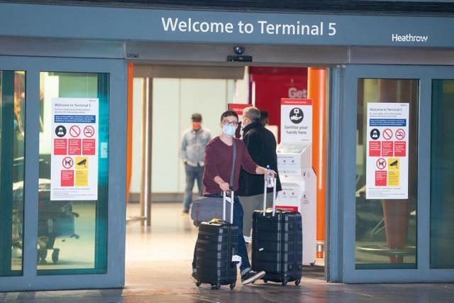 Passengers arrive at London Heathrow's Terminal 5