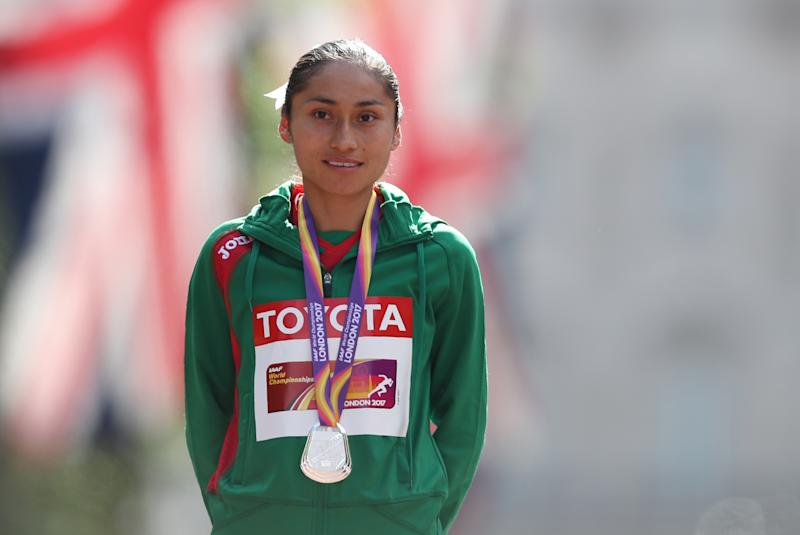 Silver medallist Mexico's Maria Guadalupe Gonzalez poses on the podium during the victory ceremony for the women's 20km race walk athletics event at the 2017 IAAF World Championships on The Mall in central London on August 13, 2017. / AFP PHOTO / Daniel LEAL-OLIVAS (Photo credit should read DANIEL LEAL-OLIVAS/AFP via Getty Images)