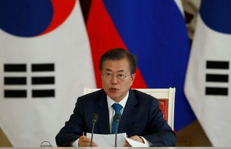 South Korean President Moon speaks during a joint news conference with Russian President Putin following the talks in Moscow