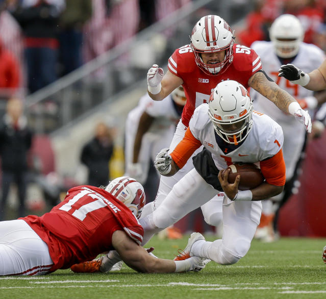 Wisconsin linebacker Andrew Van Ginkel (17) and linebacker Zack Baun tackle Illinois quarterback AJ Bush during the first half of an NCAA college football game Saturday, Oct. 20, 2018, in Madison, Wis. (AP Photo/Andy Manis)