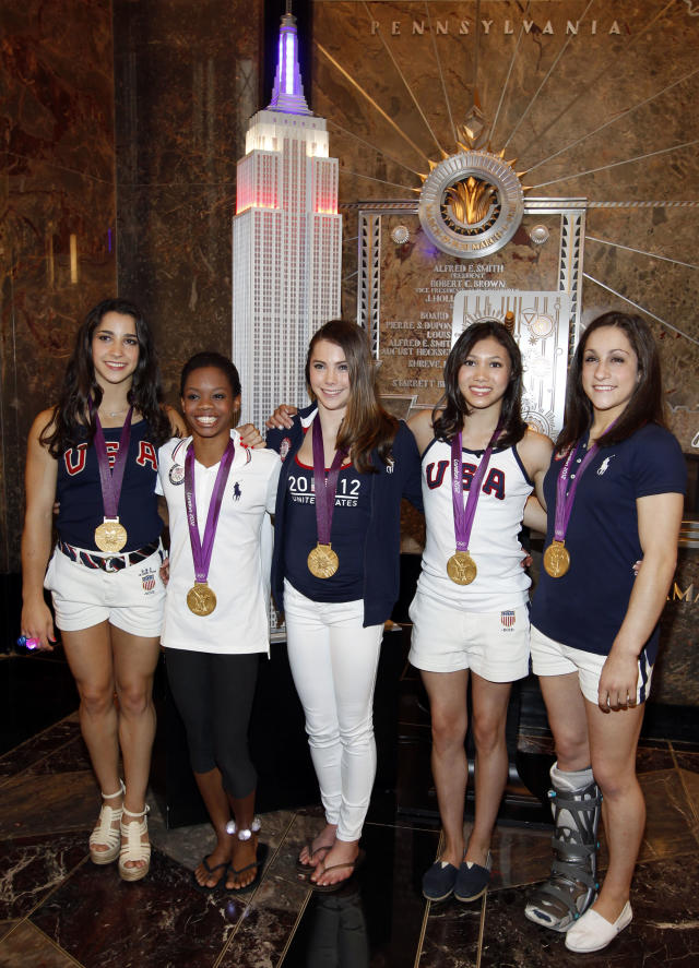 CORRECTS SPELLING OF JORDYN - Members of the 2012 US Women's Gymnastics Olympic Team, from left, Aly Raisman, Gabby Douglas, McKayla Maroney, Kyla Ross and Jordyn Wieber pose after ceremonially lighting the Empire State Building, Tuesday, Aug. 14, 2012 in New York. (Photo by Jason DeCrow/Invision/AP)