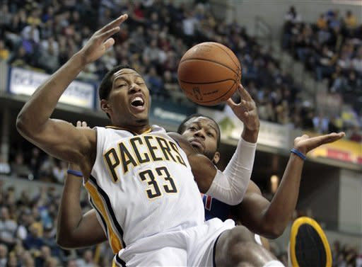 Indiana Pacers' Danny Granger, left, is fouled by Detroit Pistons' Greg Monroe as he grabs a rebound during the first half of an NBA basketball game Monday, Dec. 26, 2011, in Indianapolis. (AP Photo/Darron Cummings)