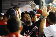 Washington Nationals' Anthony Rendon high-fives teammates in the dugout after hitting a three-run home run in the fifth inning of an interleague baseball game against the Chicago White Sox, Tuesday, June 4, 2019, in Washington. (AP Photo/Patrick Semansky)