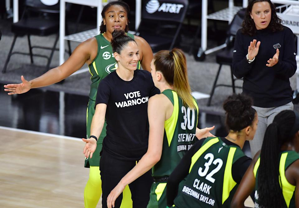 "Sue Bird in a ""Vote Warnock"" T-shirts with her Seattle Storm team."