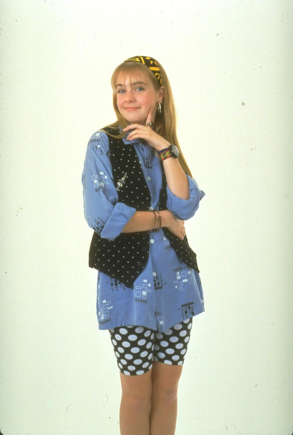 <p>To play the sarcastic leading lady from <b>Clarissa Explains It All</b>, you need spandex biker shorts, a headband, an oversize shirt, and a menswear vest.</p>