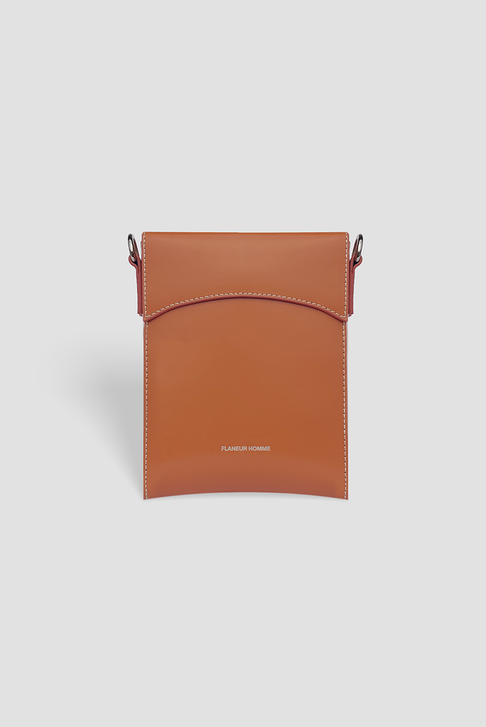 """<p><strong>Flaneur Homme</strong></p><p>flaneurhomme.com</p><p><strong>325.00</strong></p><p><a href=""""https://flaneurhomme.com/collections/leather-goods/products/nectarine-pouch-shoulder-bag"""" rel=""""nofollow noopener"""" target=""""_blank"""" data-ylk=""""slk:Shop Now"""" class=""""link rapid-noclick-resp"""">Shop Now</a></p><p>If you haven't yet climbed aboard the """"carrying a cool little pouch to hold all the stuff that's overflowing your pockets"""" train, it's officially time to do so.</p>"""