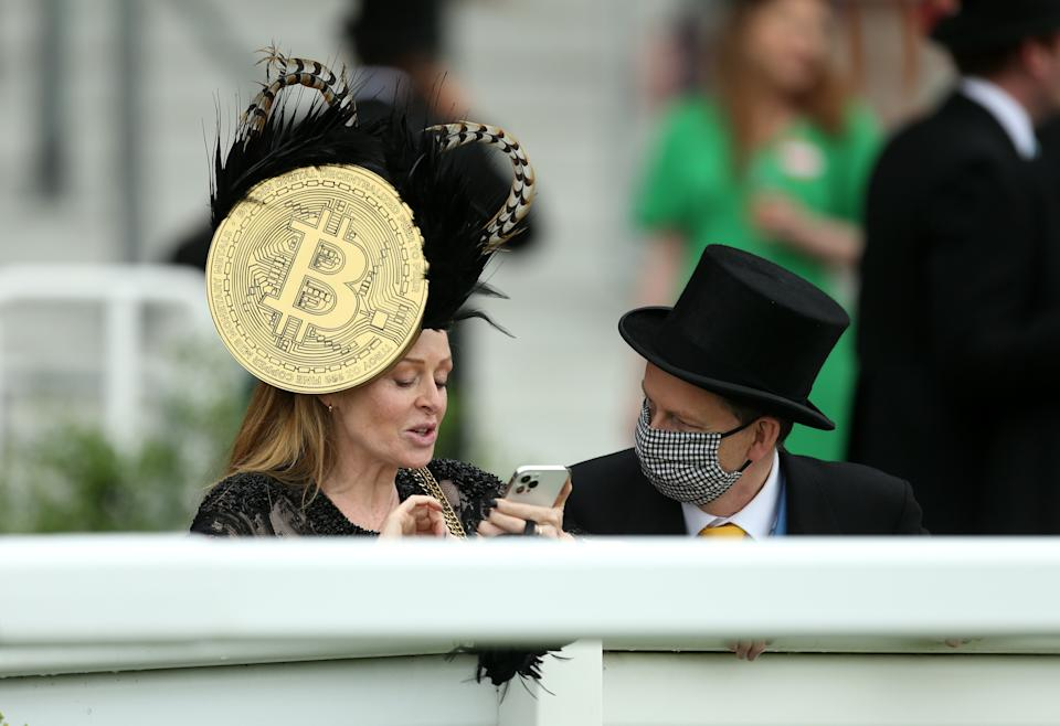 A racegoer wears a hat with a large bitcoin symbol on the side during day five of Royal Ascot at Ascot Racecourse on 19 June. Photo: Steven Paston/PA Images via Getty Images