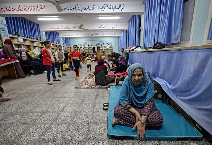 Image: Palestinian families take shelter in a UN school in Gaza City (Mahmud Hams / AFP - Getty Images)