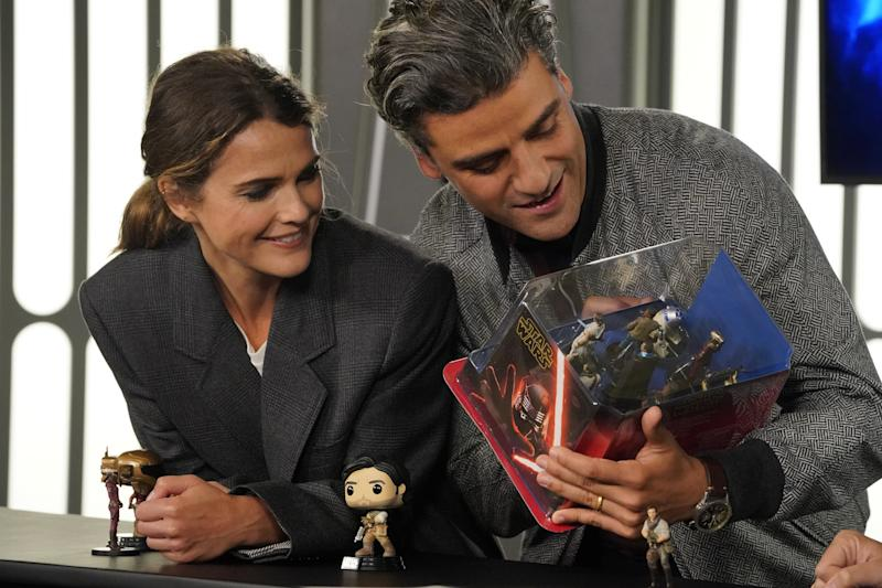 Keri Russell and Oscar Isaac sample the wares in the official Star Wars: Triple Force Friday preview.
